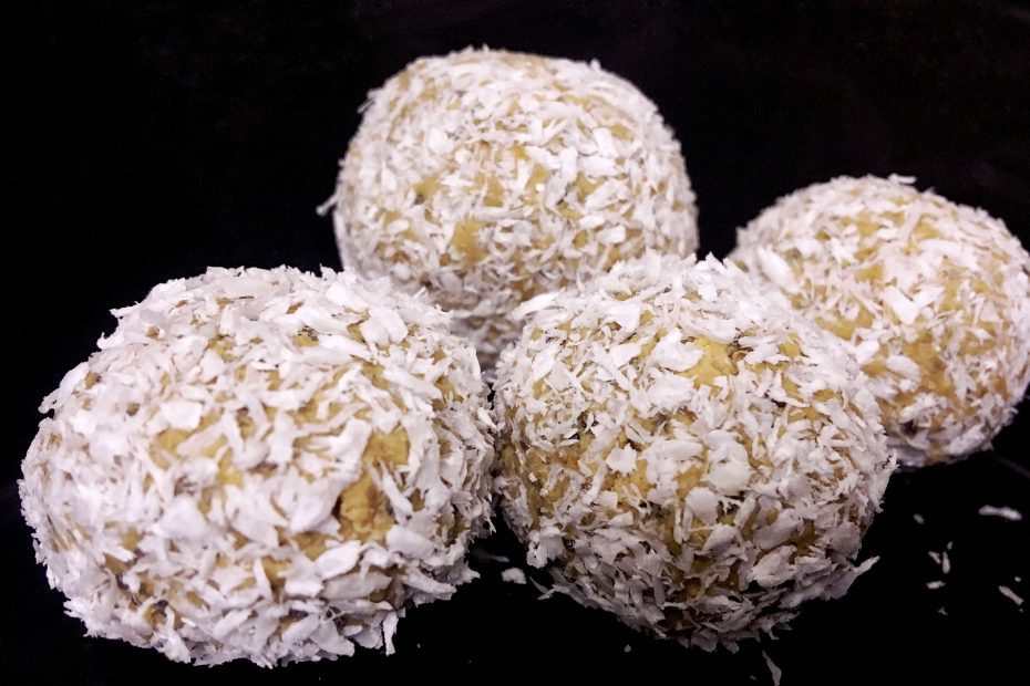 No bake energy balls covered in coconut flakes is a great healthy vegan snacks