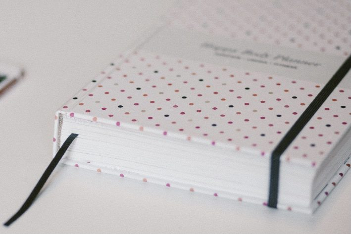 pink polka dot notebook used for daily journal prompts