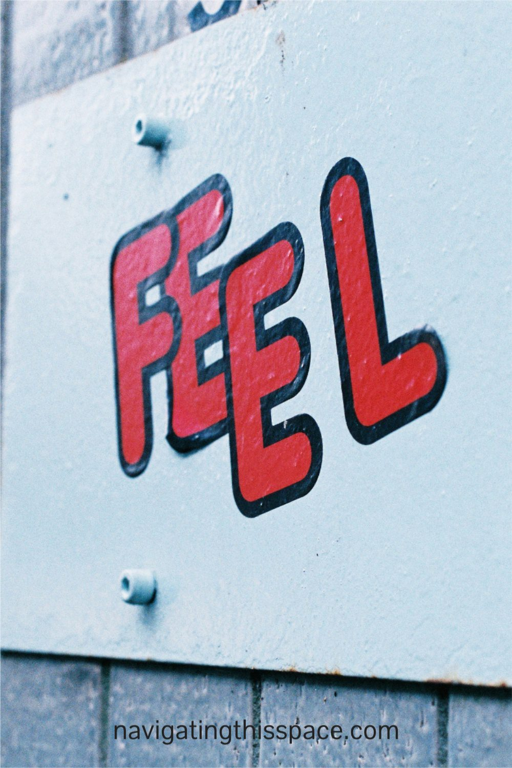 the word feel painted on a wall meaning to use your feeling when writing