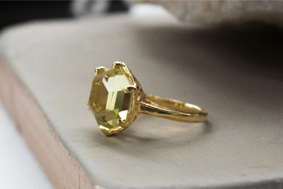 a gold ring sitting on a book