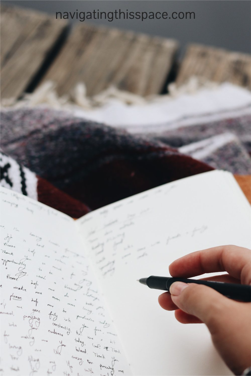 a hand writing in a journal using the tips for daily journaling
